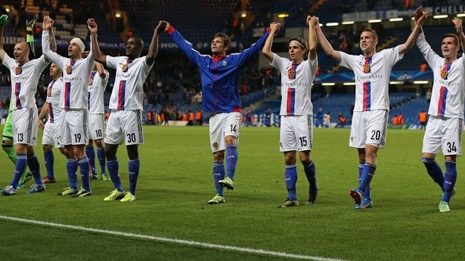 FC Basel 1893 players celebrate in front of their fans after their UEFA Champions League group stage match against Chelsea FC